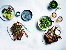 Coal-fired buttermilk brined lamb shoulder with harissa, Artischockes and salad