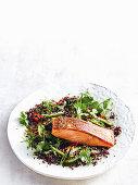 Black quinoa and cucumber salad with crispy salmon