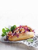 A sub sandwich with wasabi chicken balls