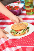 Grilled hamburger with tomatoes and onions