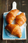 Croissants on a chopping board