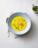 Pumpkin soup with a fried scallop and pesto