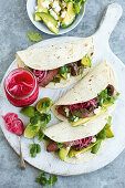 Beef fajitas with avocado, fetta and pickled onion