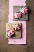 Herring salad with beetroot and red onions on pumpernickel bread