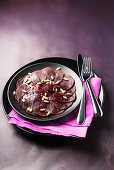 Beetroot carpaccio with pine nuts
