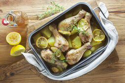 Lemon chicken in a baking dish on a wooden surface