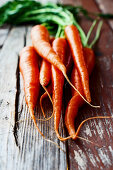 Fresh carrots on a rustic wooden surface