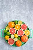 Oranges grapefruit limes lemons on a tray cocktail citrus
