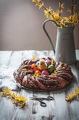 Yeast dough wreath filled with chocolate spread for Easter