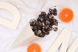 A paper cone with chocolate orange popcorn (seen from above)