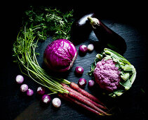 Purple cauliflower, purple cabbage, purple carrots, purple and white pearl onions and eggplant