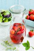 Homemade strawberry vinegar in a carafe