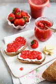 Open face sandwiches with strawberry jam and cream cheese