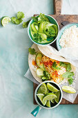 Coconut and lime fish tacos with cucumber salad