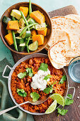 Lamb dhal with naan bread and steamed vegetables