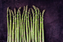 Green asparagus spears with water drops