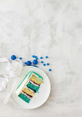 Blue layered sponge with ganache drizzle