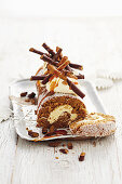Cheesecake swiss roll with gingerbread sticks