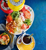 A Chinese salad plate with plum sauce (Chinese New Year)