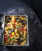 Tray-bake pasta with garlicky mushrooms and tomatoes