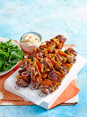 Mediterranean skewers with lebanese bread, lamb and bell pepper