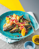 Fish with citrus and pomegranate salsa