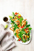 Spicy prawn wombok and shredded pea salad