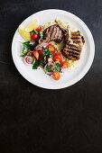 Lamb cutlets with zucchini hummus
