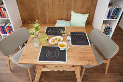 Place mats handmade from chalkboard fabric on rustic wooden table