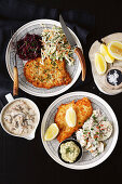 Wiener schnitzel with red cabbage, vegetable and potato salad and hunter's sauce