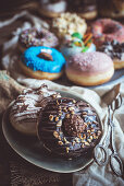 Sweet chocolate donuts served in the plate, selective focus