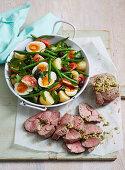 Herb-stuffed Mini Lamb Roast with Nicoise Salad