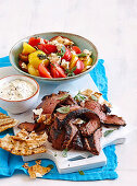 Skirt steak with tomato and feta salad