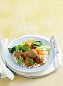 Satay pork meatballs with veg and rice