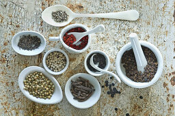 A still life with different types of pepper (top view)