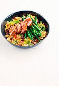 Cajun-spiced pork with black bean rice salad