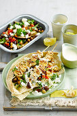 Greek chicken skewers with warm eggplant salad