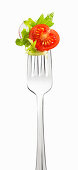 Lettuce, tomato and radish on a fork