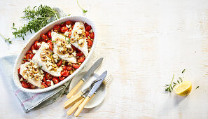 Baked zander in a tomato and herb sauce