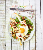 Roasted asparagus with mushrooms and fried egg