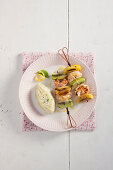 Prawn skewers with green and yellow kiwis served with rice