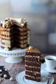 A popcorn drip cake with peanut butter cream and caramel, sliced