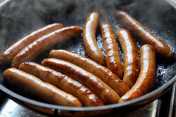 Merguez sausages in a pan