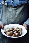Bowl of mushrooms being held by a farmer