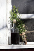 Homemade hair oil made from birch leaves, stinging nettles, rosemary and olive oil