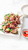 Lamb cutlets with eggplant basil fry-up and quick chilli pickle