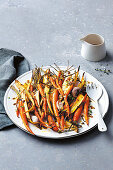 Roasted baby carrots and parsnips with honey and mustard dressing