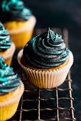 Cupcakes with black buttercream and glitter