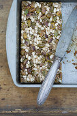 A granola bar with pistachios, sunflower seeds and sesame seeds