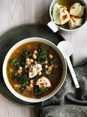 Chickpea, quinoa and kale soup with labne